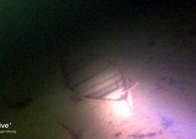 Boot im dunklen Tegernsee